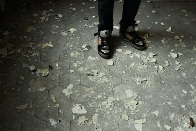 Person standing on damaged floor